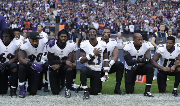 Baltimore Ravens players kneel in protest during the national anthem at Wembley Stadium in London on Sept. 24.