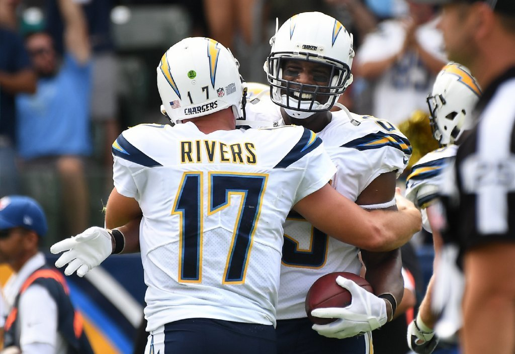 Chargers quarterback Philip Rivers congratulates tight end Antonio Gates after his 112th career scoring reception. (Wally Skalij / Los Angeles Times)