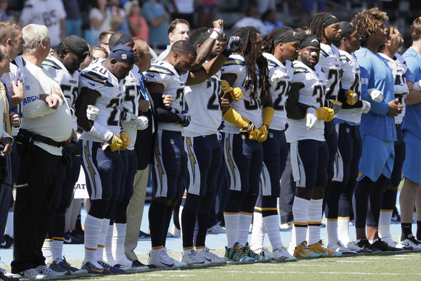 The San Diego Chargers link arms during the national anthem in a game against the Kansas City Chiefs at StubHub Center.