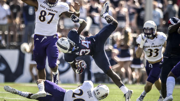 East Carolina holds off Connecticut 41-38 in rescheduled game