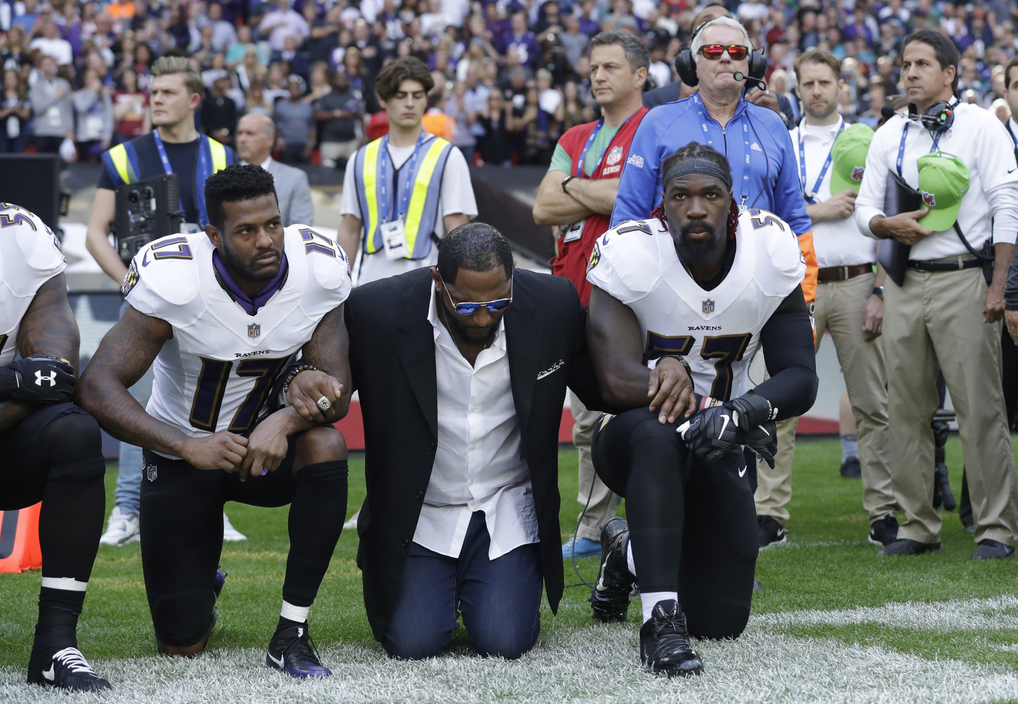 As trump continues his attacks nfl players protest by kneeling or locking arms la times