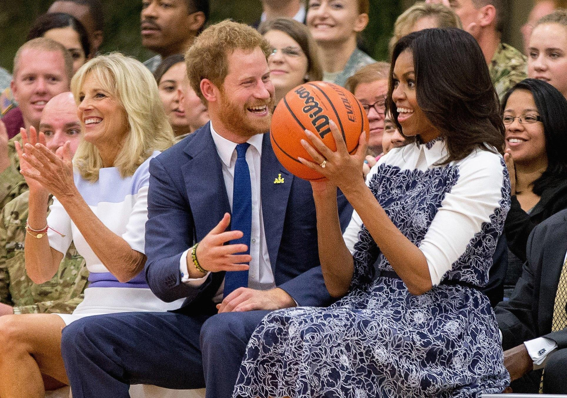 Jill Biden, left, Prince Harry and then-First Lady Michelle Obama in 2015. (Andrew Harnik / Associated Press)