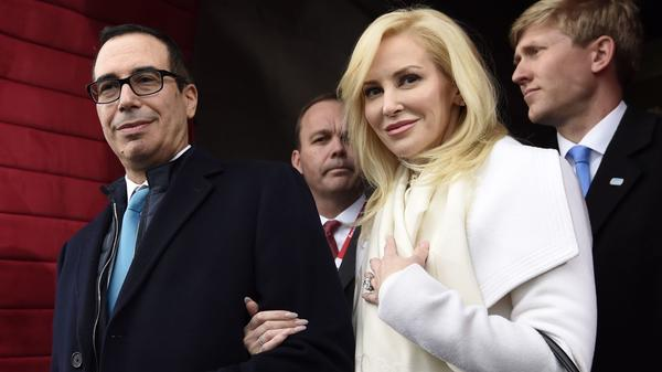In this Jan. 20, 2017, Stephen T. Mnuchin and then-fiancee Louise Linton arrive on Capitol Hill in Washington for the presidential inauguration. (Saul Loeb / Pool Photo via AP, File)