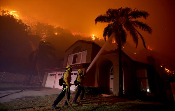 Fast-moving wildfire burns 2,000 acres, damaging one home as hundreds evacuated