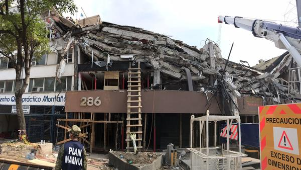 The upper stories at this office building at Avenida Alvaro Obregon 286 in Mexico City have collapsed, leaving entire floors stacked like pancakes.