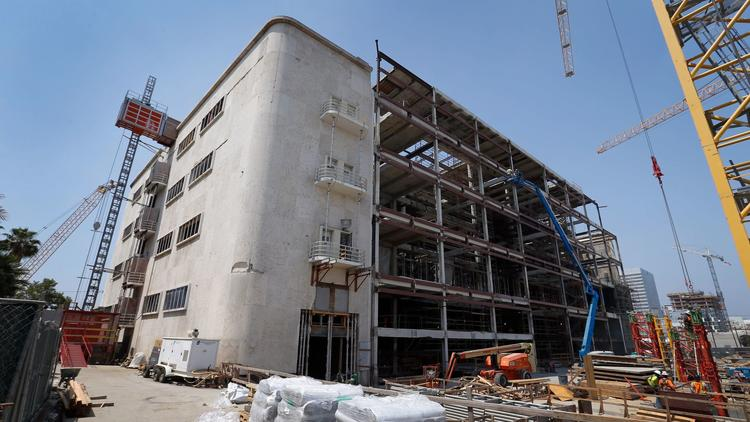Construction is underway at the site of the future Academy Museum of Motion Pictures at the corner of Wilshire Boulevard and Fairfax Avenue. (Allen J. Schaben / Los Angeles Times)