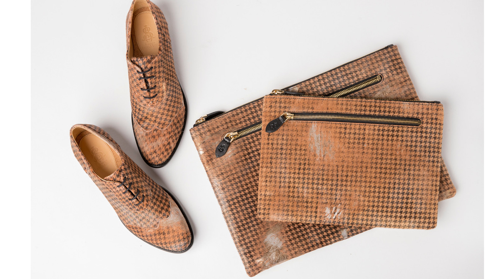 A bag line from Los Angeles brand the Office of Angela Scott joins the label's menswear-inspired women's shoes. Here are houndstooth print selections from the brand's fall/winter collection.