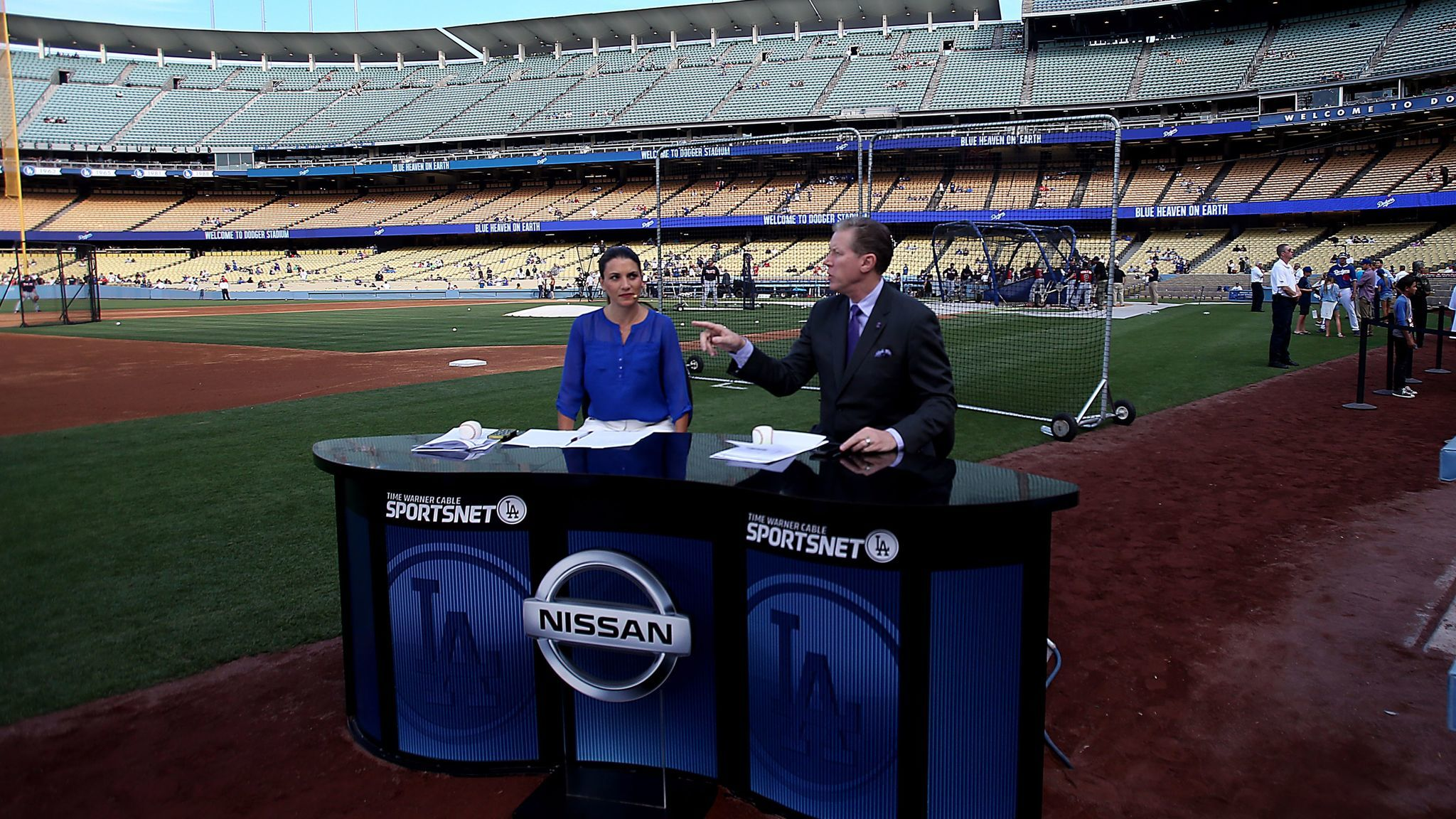 Time Warner Sportsnet Dodgers commentators Alanna Rizzo, left, and Orel Hershiser, do a pregame show before the Dodgers face the Atlanta Braves.
