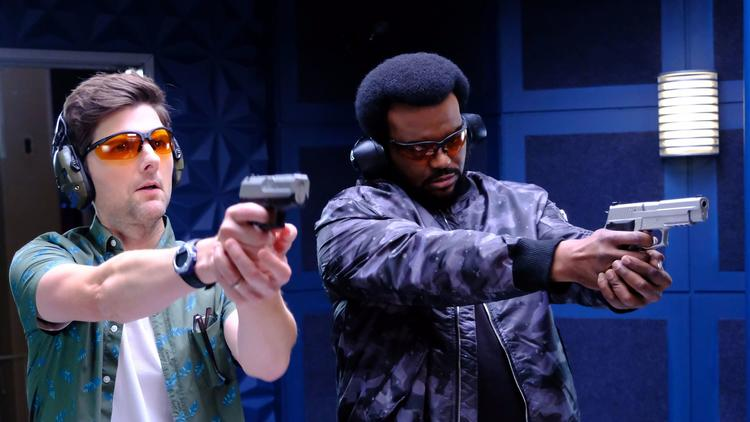 "Adam Scott, left, and Craig Robinson in an upcoming episode of the Fox series ""Ghosted."" (Kevin Estrada / Fox)"