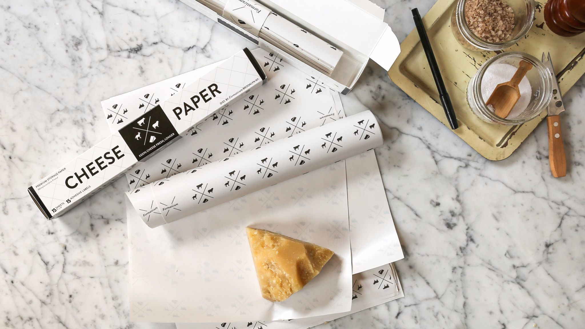 Rolls of coated cheese paper help preserve the life of cheeses.