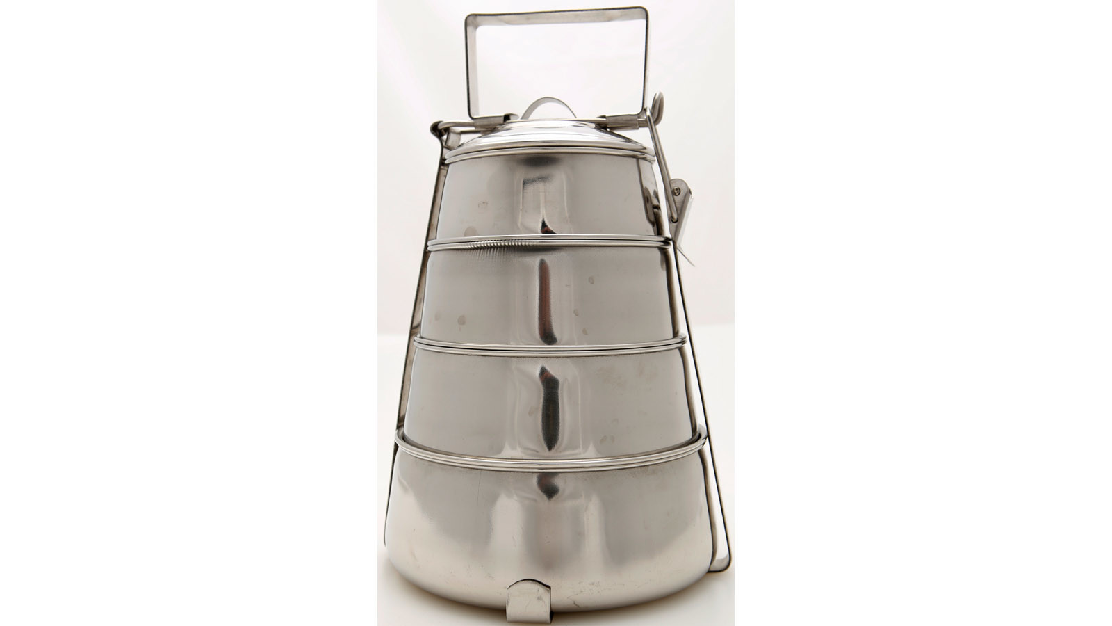 An Indian-style stacked metal lunchbox called a tiffin.