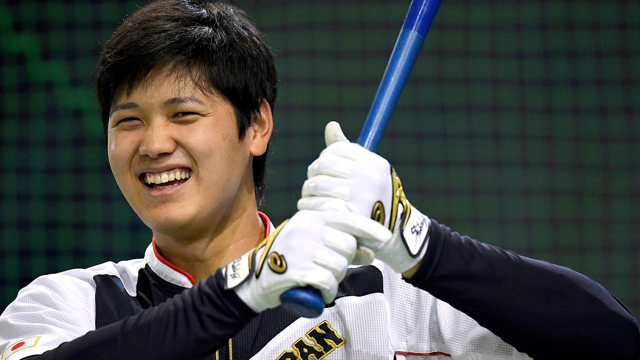 Shohei Ohtani warms up ahead of an international friendly game between Japan and the Netherlands at the Tokyo Dome on Nov. 12, 2016.