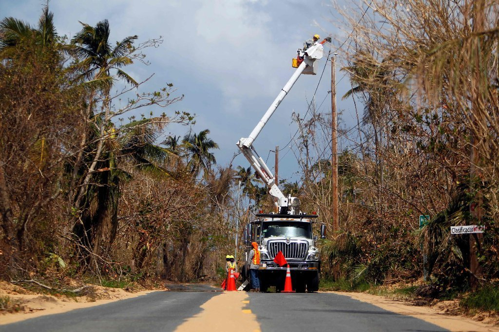 Puerto Rico Power Authority workers repair power lines in the aftermath of Hurricane Maria, in Loiza, Puerto Rico, September 28, 2017.