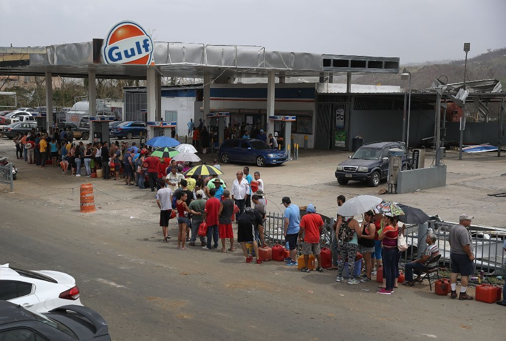 People wait in line for gas as they deal with the aftermath of Hurricane Maria on September 27, 2017 in Corozal, Puerto Rico.