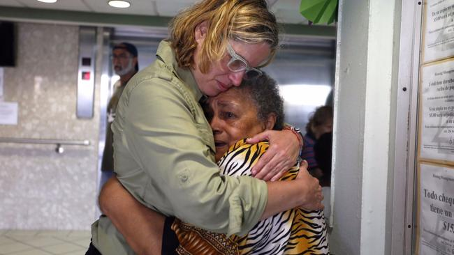 San Juan Mayor Carmen Yulin Cruz, left, hugs a woman while visiting a home. (Thais Llorca / European Pressphoto Agency)