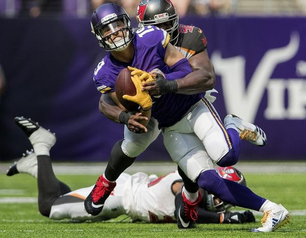 Vikings receiver Adam Thielen makes a catch against the Buccaneers during a game on Sept. 24. (Carlos Gonzalez / Minneapolis Star Tribune)