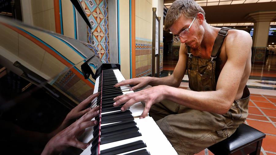 "Matthew Shaver plays the free piano at Union Station in Los Angeles. He describes it as his ""meditation"". — Photograph: Al Seib/Los Angeles Times."