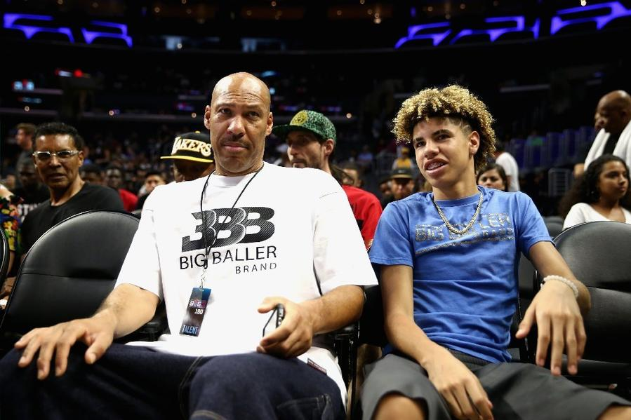 LaVar Ball and LaMelo Ball look on from the crowd during a BIG3 three-on-three game at Staples Center on Aug. 13. (Sean M. Haffe / Getty Images)