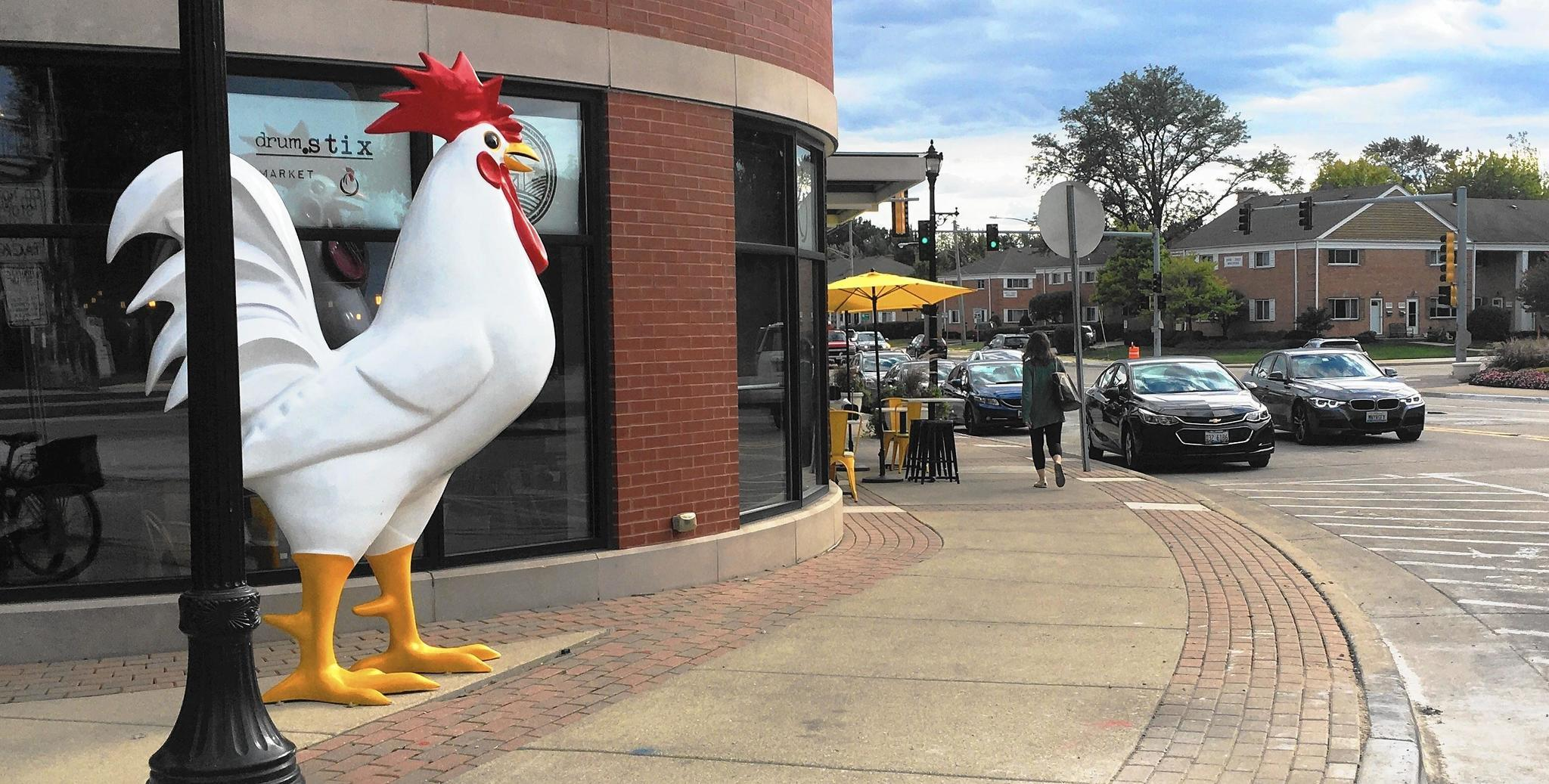 Downtown northbrook now home to 7 foot tall chicken for Lucky fish northbrook