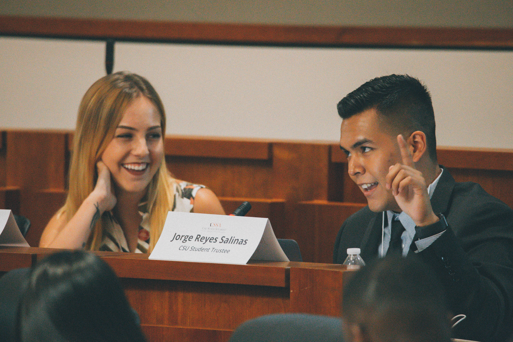 Cal State student trustee Jorge Reyes Salinas, right, with fellow student trustee Emily Hinton at a meeting in July.