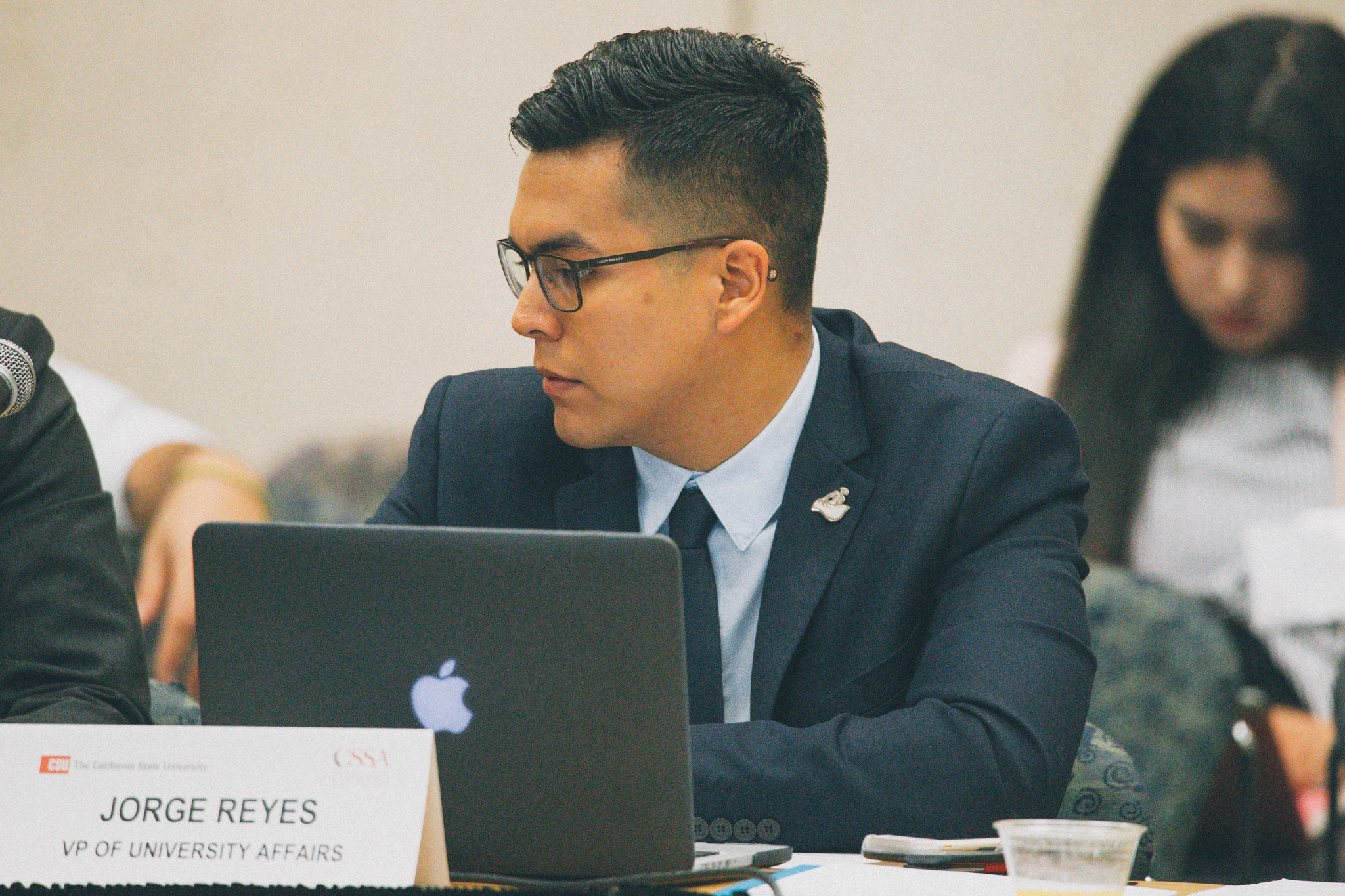 Student trustee Jorge Reyes Salinas chairs a meeting in April.