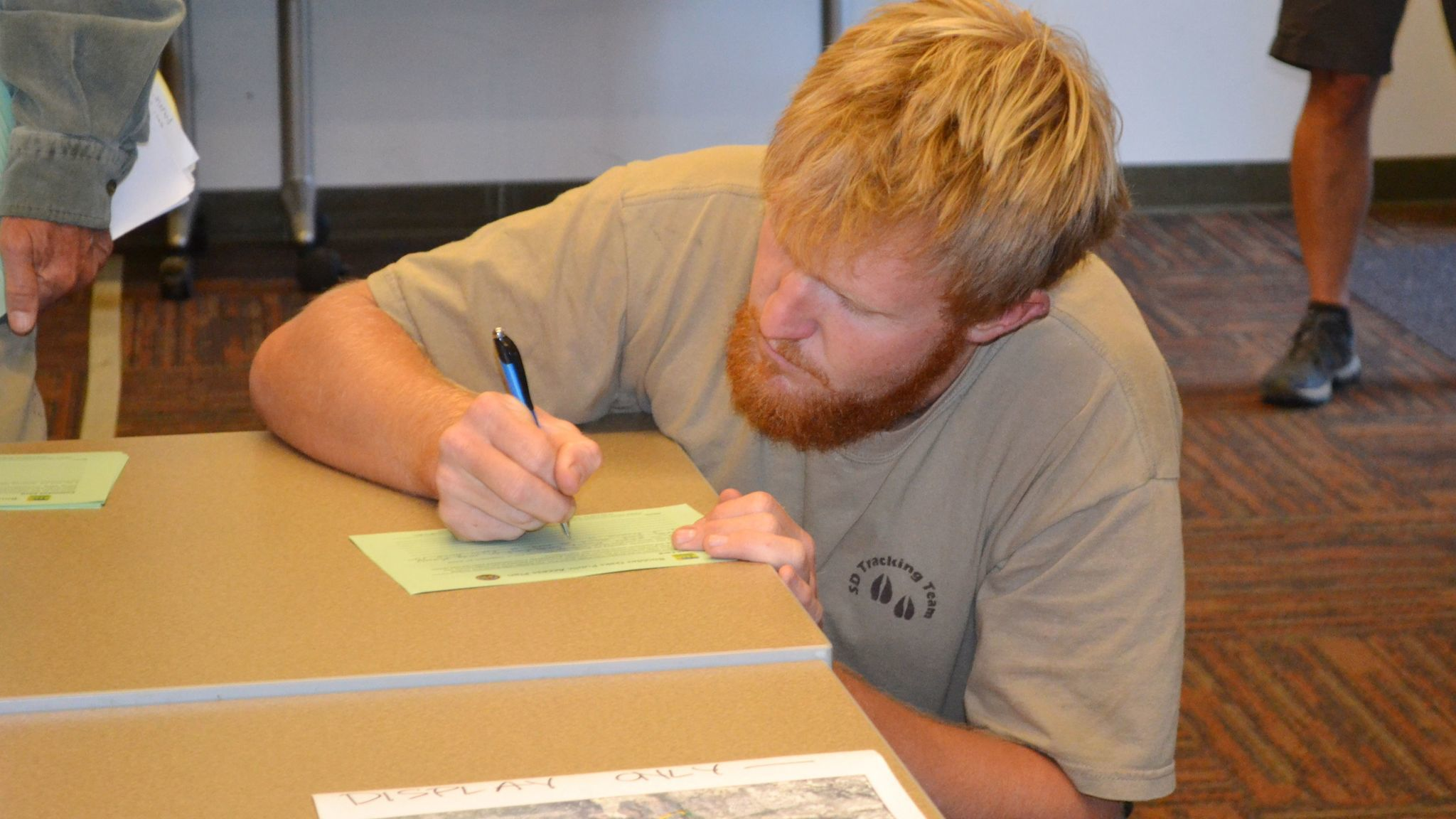 Mussey Grade Road resident Chris Meador fills out a comment card.