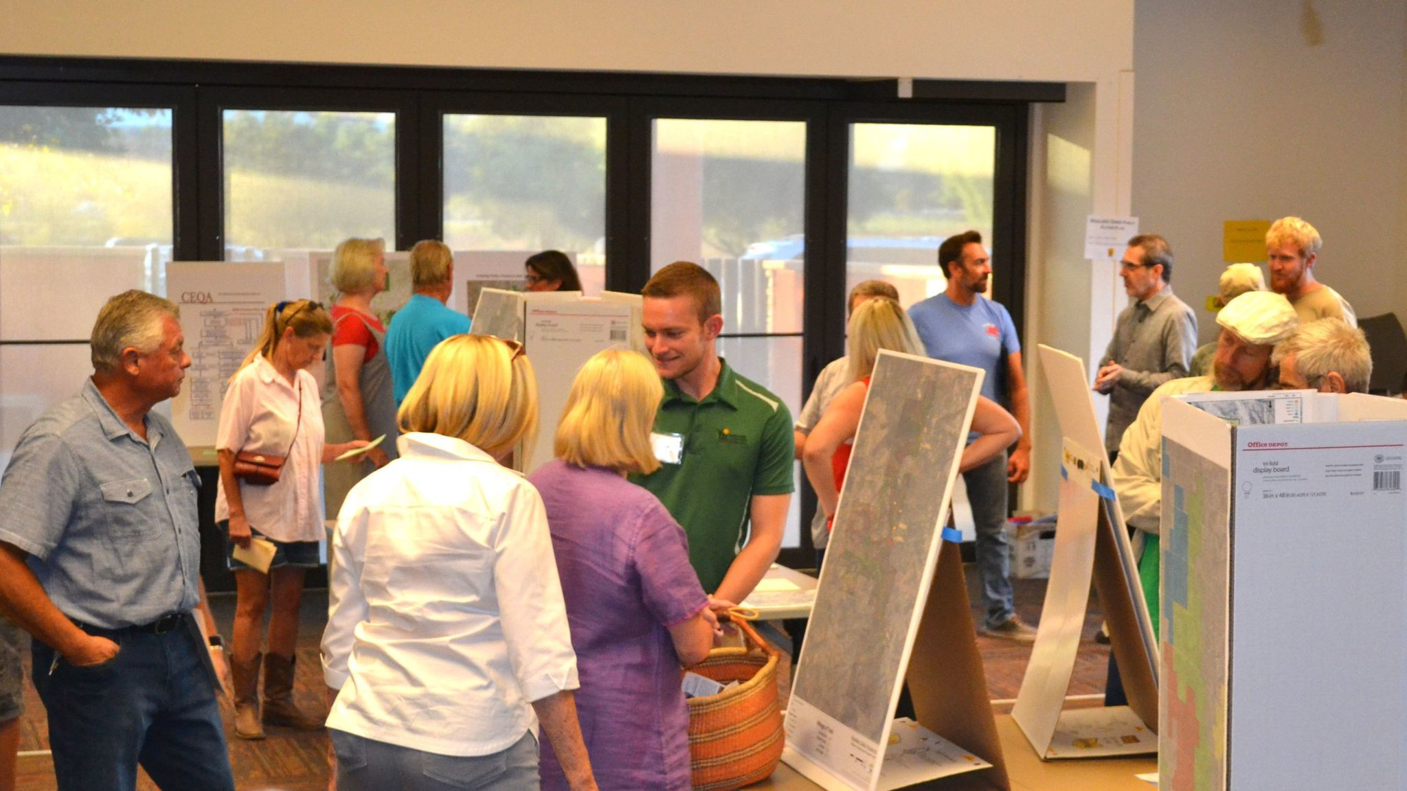 Residents view the county's proposed trail plan for Boulder Oaks Preserve.