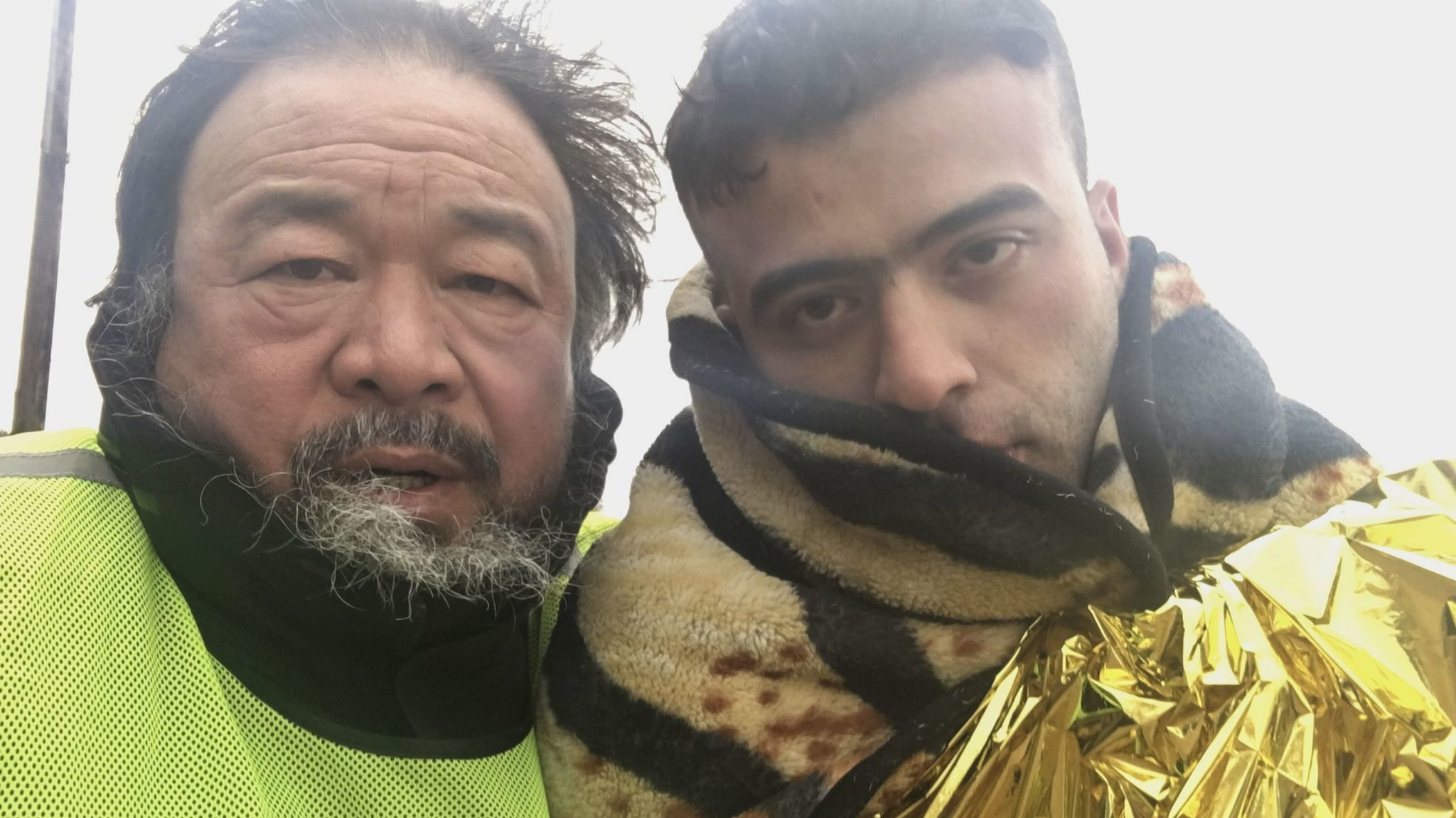 """Ai Weiwei with Muhammed Hassan from Iraq on Lesvos Island in Greece, from the documentary """"Human Flow."""""""
