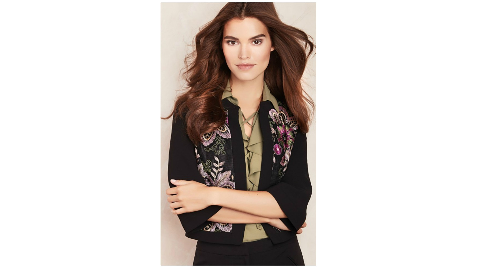 Tahari ASL black blazer with olive blouse with neck ruffle detail.