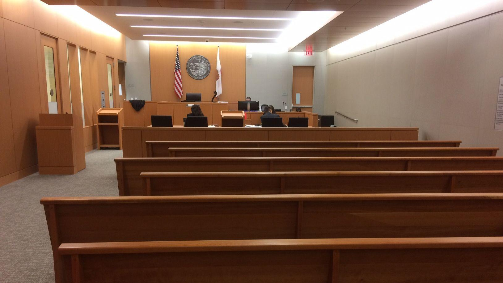 A few court staff handle some duties sitting in one of the courtrooms at the new San Diego Superior