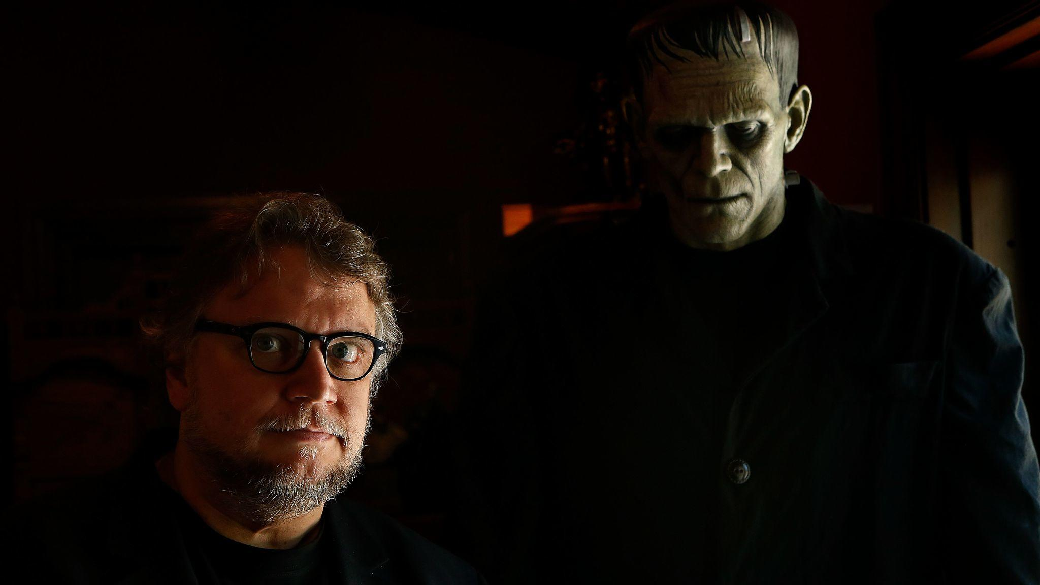Guillermo del Toro is photographed next to a creature of Frankenstein, on display inside his monster themed Bleak House in Westlake Village on June 13, 2016. (Mel Melcon / Los Angeles Times)