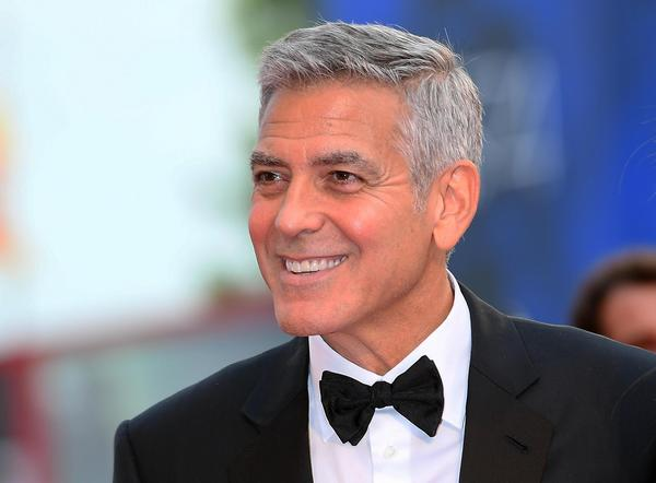 "George Clooney arrives Sept. 2 for the premiere of ""Suburbicon"" during the Venice Film Festival. (Claudio Onorati / Venice Film Festival)"