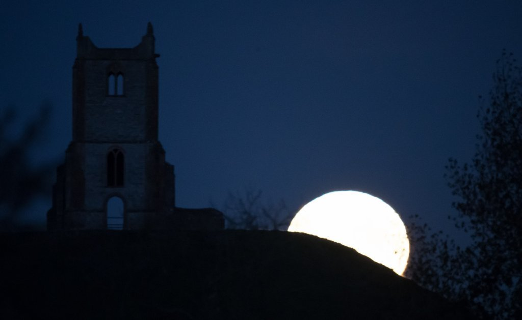 The full Harvest moon rises over the ruins of St Michael's Church, a scheduled monument on the top of Burrow Mump on October 5, 2017 in Somerset, England.