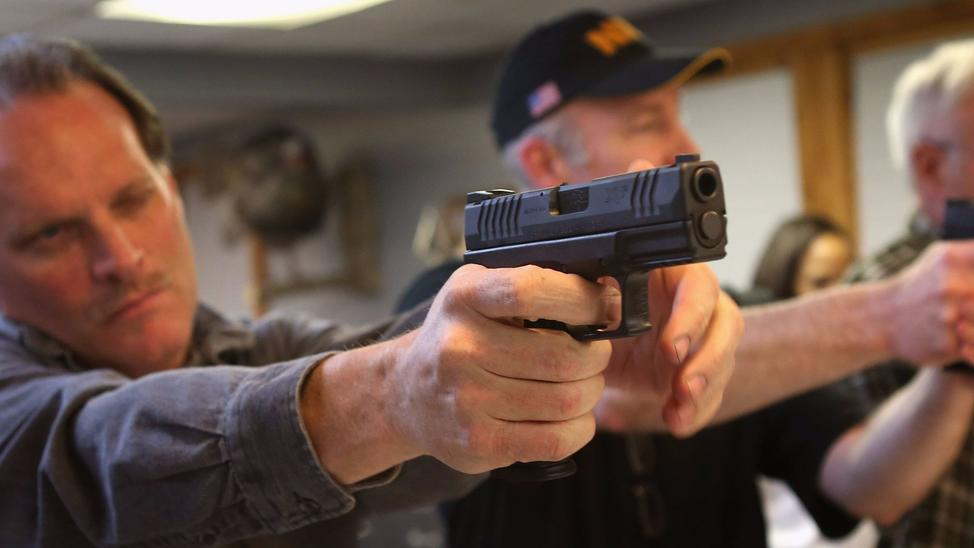 "Students learn how to fire a pistol during an NRA Basic Pistol Course on ""Gun Appreciation Day"" in Tinley Park, Illinois on January 19th, 2012. — Photograph: Scott Olson/Getty Images."