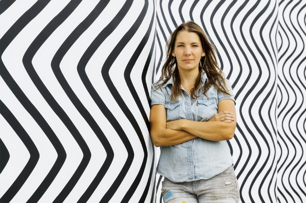 "Artist Claudia Comte in front of her ""Curves and Zig Zags,"" which she created for the inaugural Desert X."