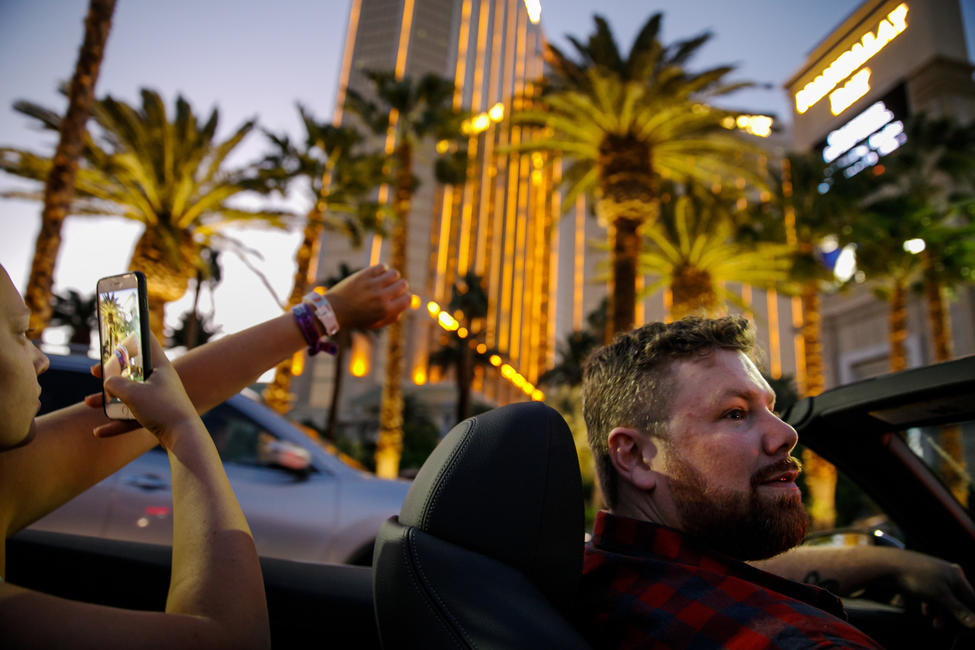 Brian MacKinnon drives through Las Vegas in the days after the shooting. — Photograph: Marcus Yam/Los Angeles Times.