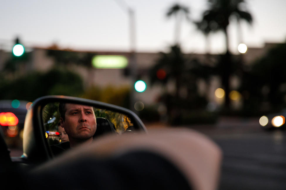 "Sean Alexander gets emotional as he listens to Cole Swindell's song ""You Should Be Here"" on the radio. — Photograph: Marcus Yam/Los Angeles Times."