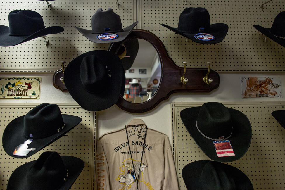 The hat display at Silva Saddle Western Wear in Anchorage. Adrian Murfitt had purchased a Stetson there for his trip to Las Vegas. — Photograph: Ash Adams/Los Angeles Times.