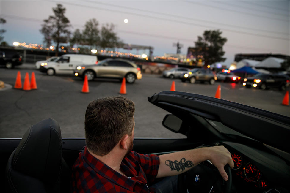 Brian MacKinnon drives the car rented by his friend Adrian Murfitt through Las Vegas after the Strip reopened. — Photograph: Marcus Yam/Los Angeles Times.