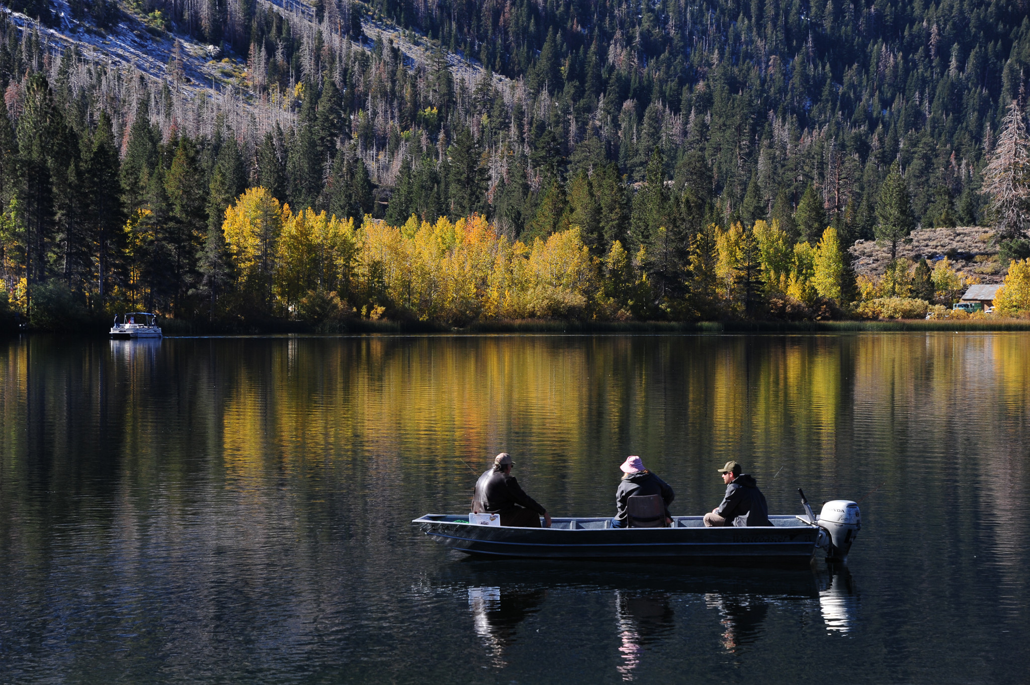 Fall colors reflected in Gull Lake on the June Lake Loop of U.S. Highway 395.