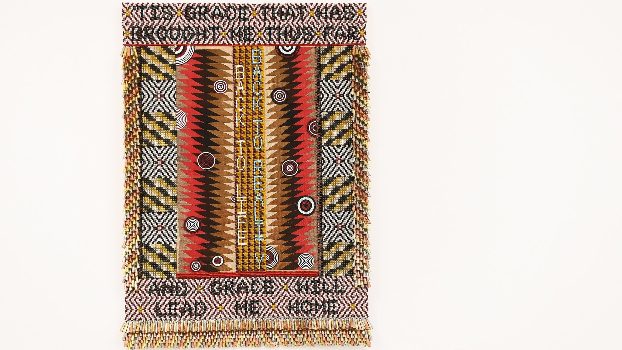"Jeffrey Gibson's ""Amazing Grace,"" 2017, glass beads, artificial sinew, trading post weaving, steel studs, copper and tin jingles, acrylic felt, canvas, wood. 76 inches by 54 inches"