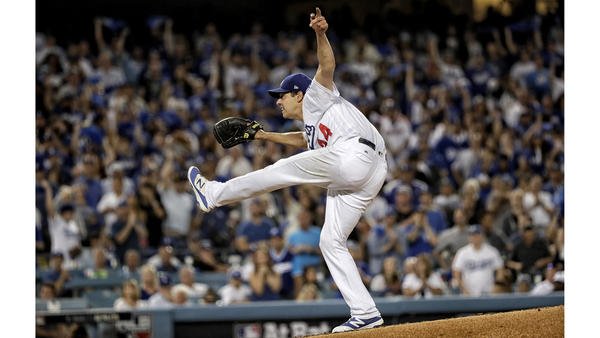 Rich Hill recoils after forcing Dbacks Chris Iannetta to ground out to end the inning. (Robert Gauthier / Los Angeles Times)