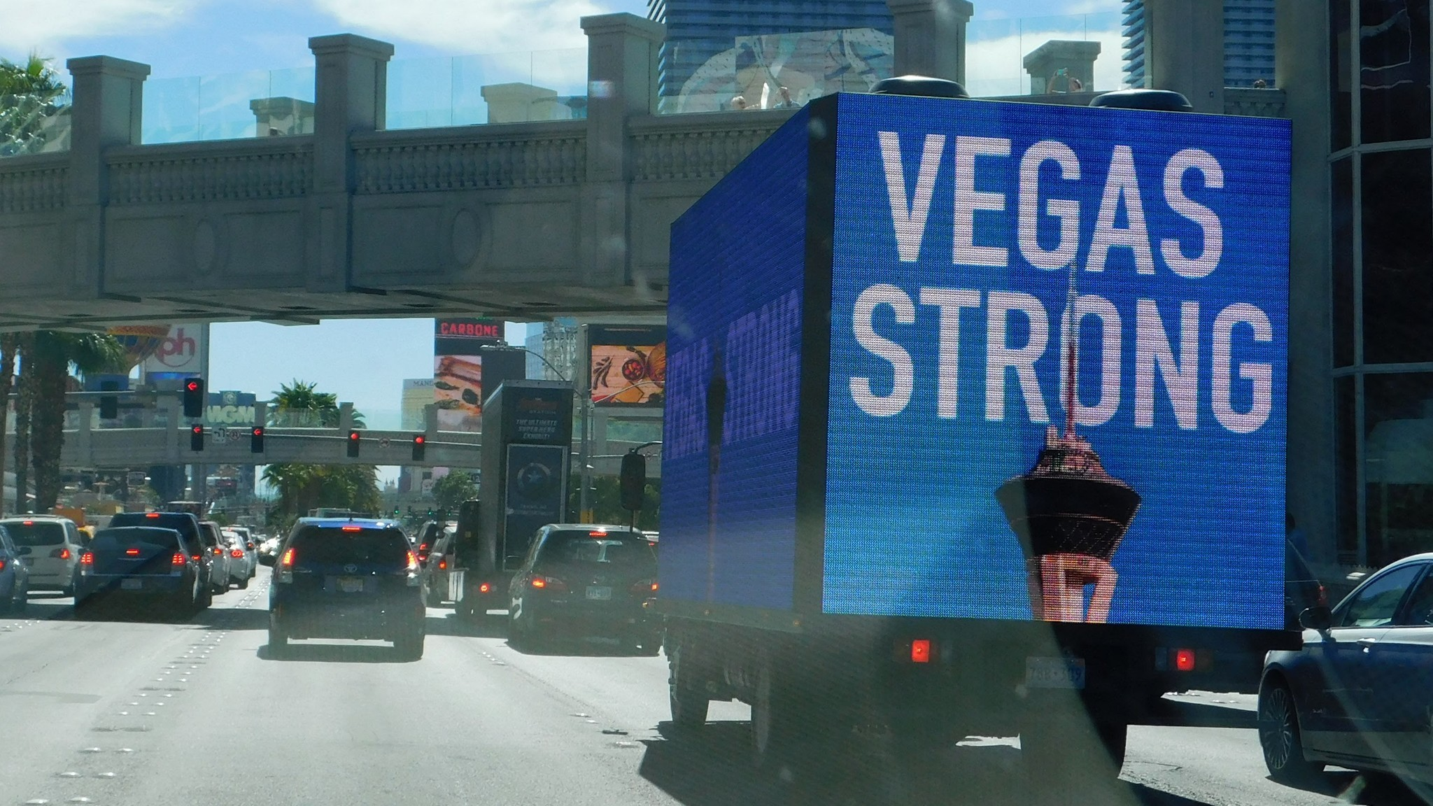 An electronic billboard moves along the Las Vegas Strip on Oct. 7.