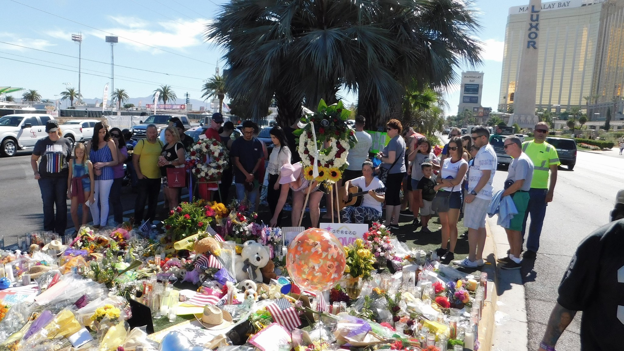 In a median along Las Vegas Boulevard, locals and tourists come to pay their respects to the 58 people who died.