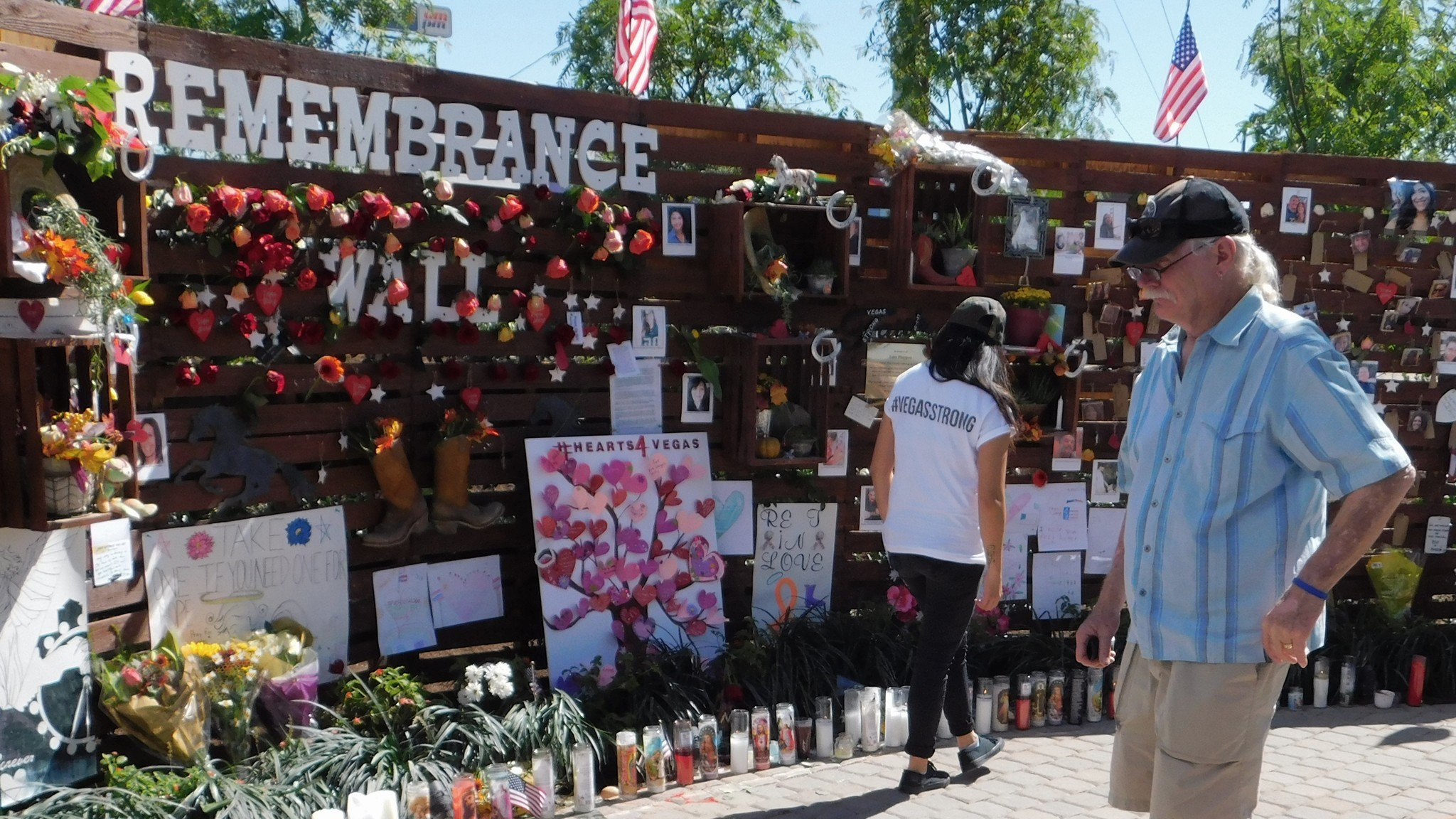 """A woman wearing a """"Vegas Strong"""" T-shirt is among those visiting the Las Vegas Community Healing Garden, which opened Saturday."""