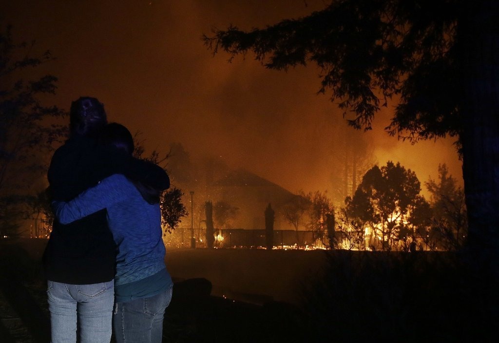 Raging wine country wildfires burn homes; force evacuations