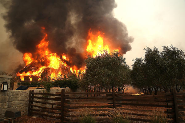 Fire consumes a barn in Glen Ellen, California. (Justin Sullivan/Getty Images)