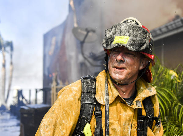 Capt. Chris Lingwall of Brea after attempting to save a home whose roof was on fire. (Stuart Palley)
