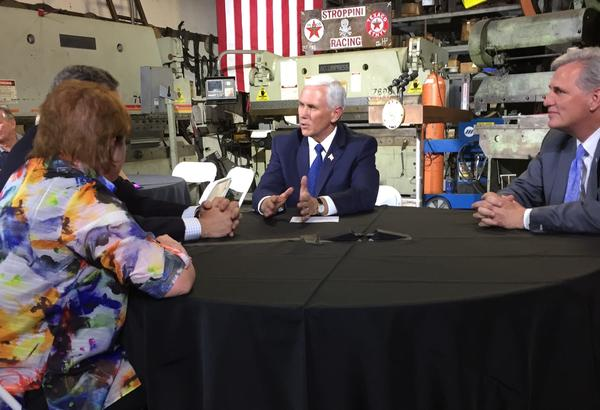 Vice President Mike Pence, center, and House Majority Leader Kevin McCarthy (R-Bakersfield), right, talk with small-business owners about President Trump's tax plan. (Liam Dillon / Los Angeles Times)