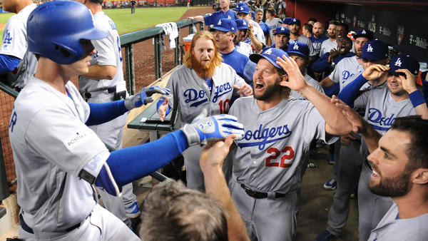 Cody Bellinger is mobbed by teammates after hitting a homerun. (Wally Skalij / Los Angeles Times)